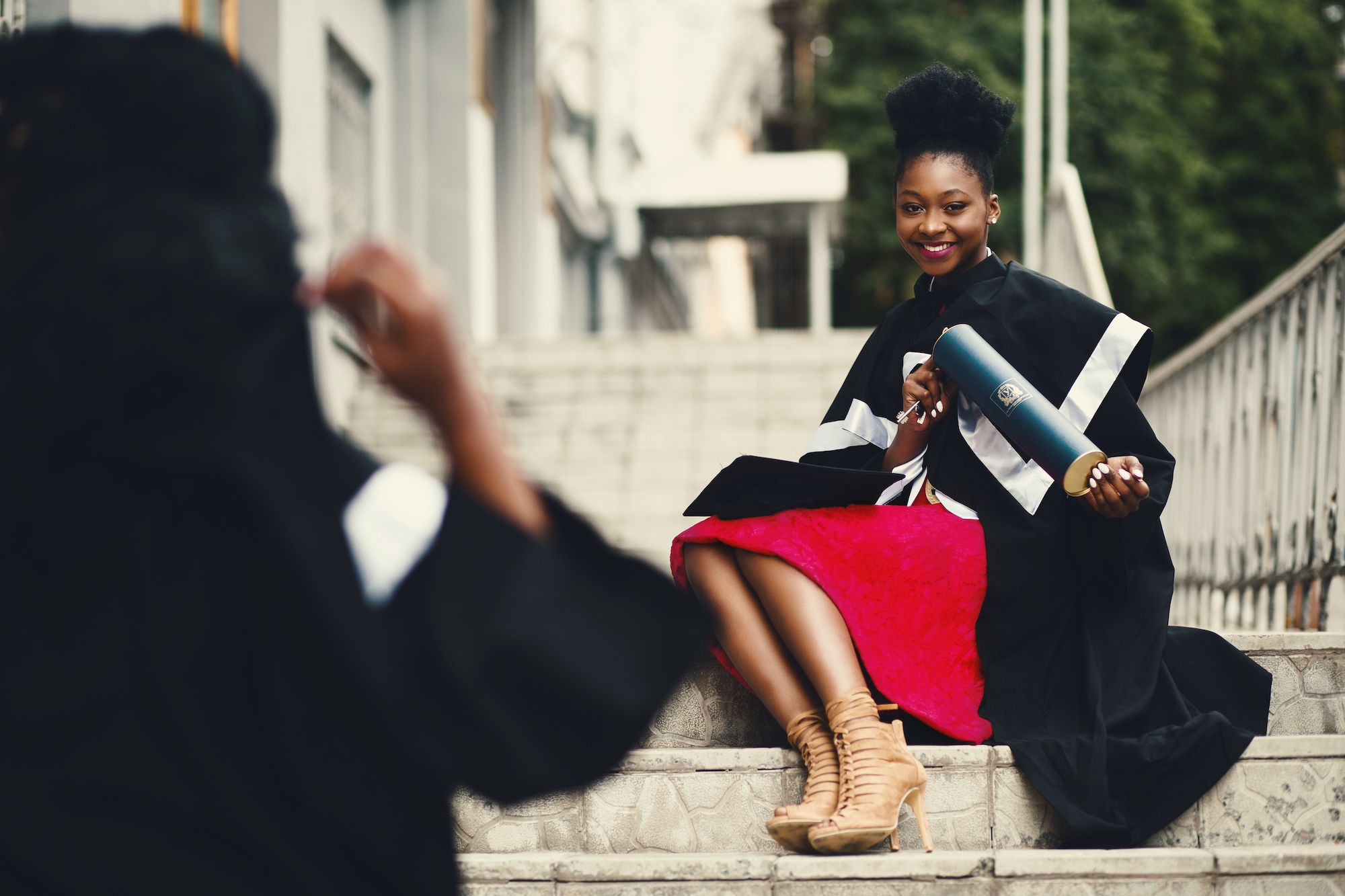 An African lady wearing her graduation gown