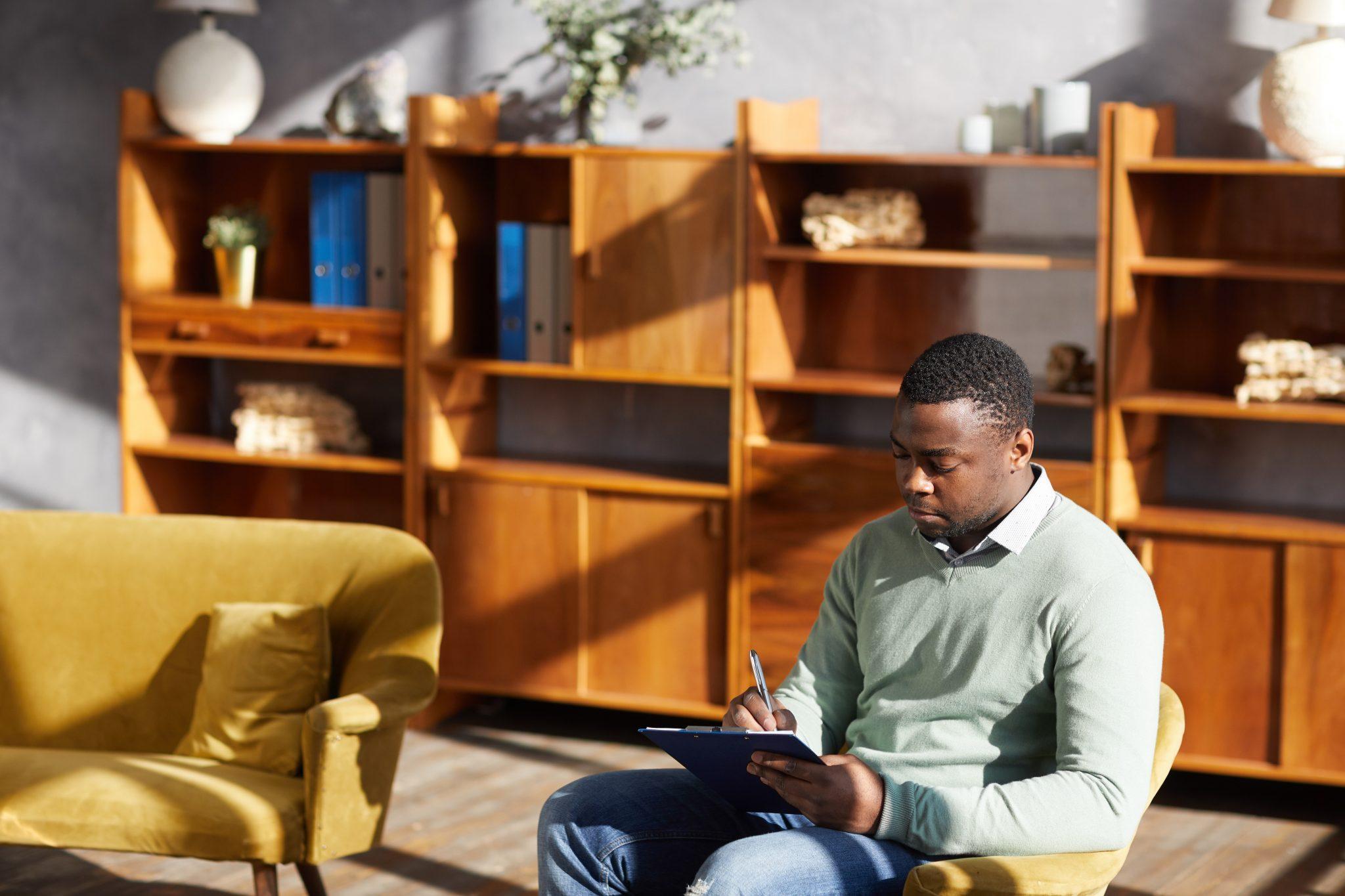 An African man writing his LinkedIn summary
